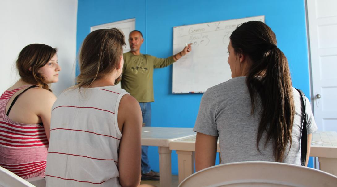 Volunteers discussing among themselves what certain words could mean in their Spanish lesson